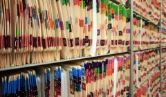Ein Regal aus Altakten - Outsourcing von Archivierung - Archivdiensleistung